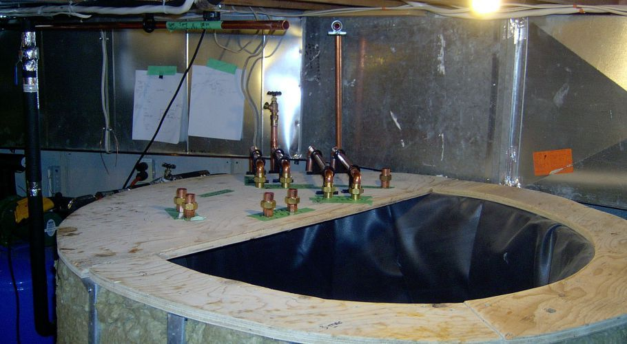 7 - Lid with layout of pipes going into the tank
