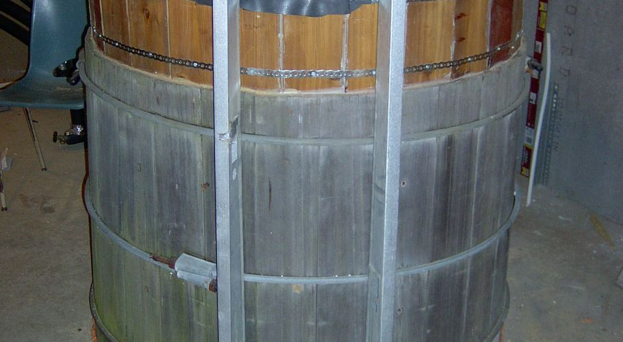 A 5 - Enlarged tank with lid and metal studs to hold insulation